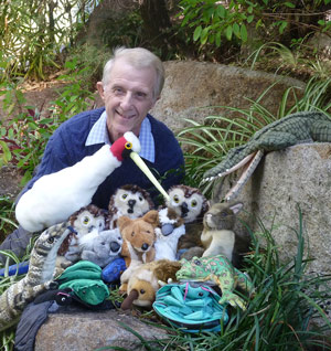 Author Peter Taylor with puppets of characters from Once a Creepy Crocodile